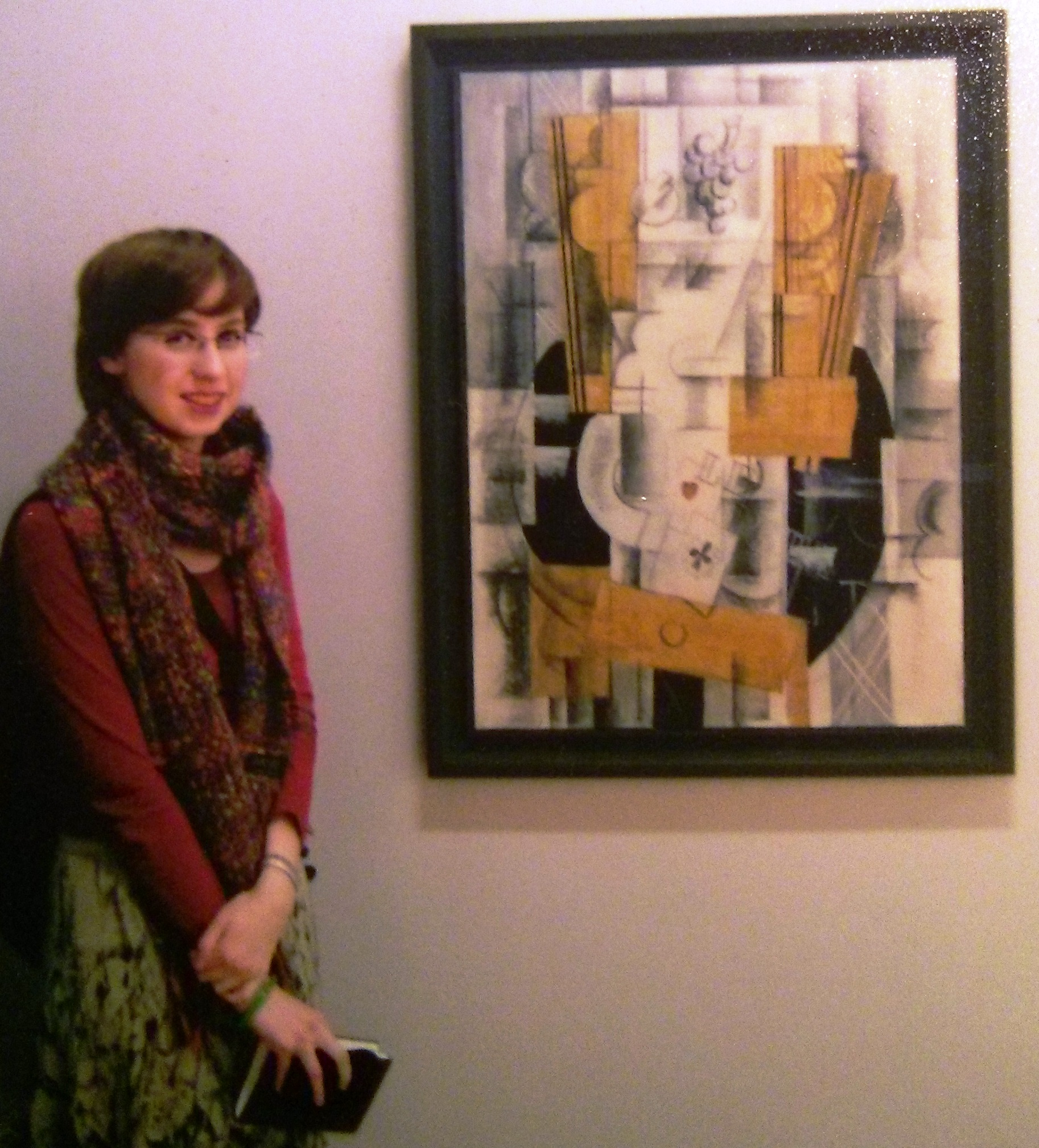 Chloé Wolifson with Georges Braque's Compotier et cartes, 1913, oil pencil and charcoal on canvas, 81 x 60 cm, at Centre Pompidou, Paris, December 2007.