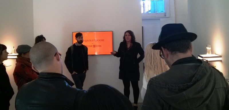 4a Curators' Intensive participants listening to gallerist Amanda Rowell discuss Archie Moore's exhibition Les Eaux d'Amoore at The Commercial, Sydney. Photograph: Chloé Wolifson